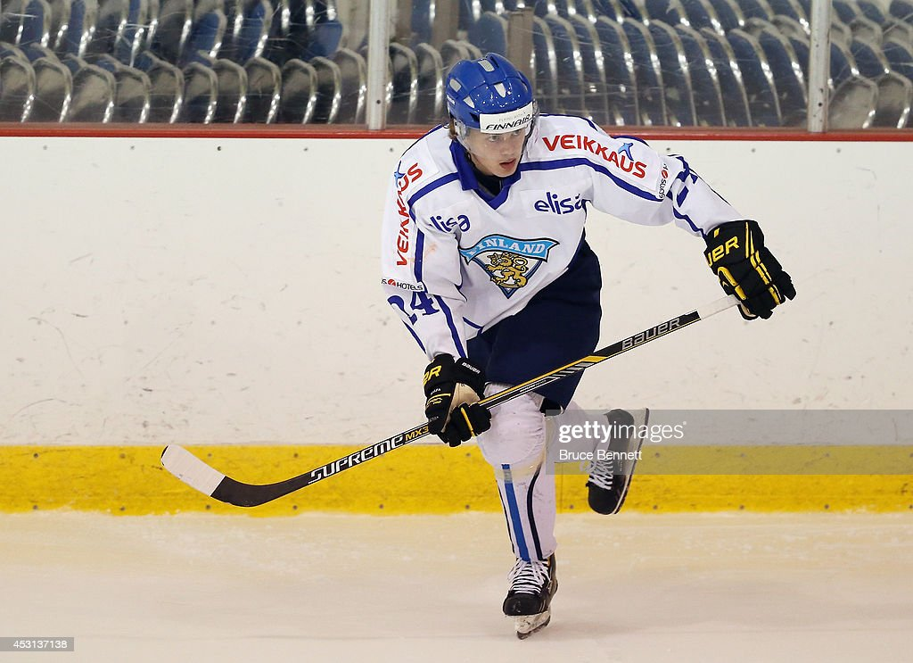<a gi-track='captionPersonalityLinkClicked' href=/galleries/search?phrase=Kasperi+Kapanen&family=editorial&specificpeople=8807180 ng-click='$event.stopPropagation()'>Kasperi Kapanen</a> #24 of Team Finland skates against USA Blue during the 2014 USA Hockey Junior Evaluation Camp at the Lake Placid Olympic Center on August 3, 2014 in Lake Placid, New York.