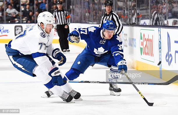 Kasperi Kapanen of the Toronto Maple Leafs battles for the puck with Victor Hedman of the Tampa Bay Lightning during NHL game action February 29 2016...