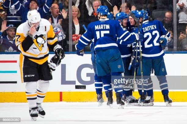 Kasperi Kapanen of the Toronto Maple Leafs celebrates his goal against the Pittsburgh Penguins with teammates Nikita Zaitsev Matt Martin and Matt...