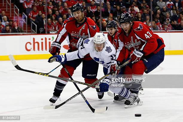 Kasperi Kapanen of the Toronto Maple Leafs goes after the puck against Brooks Orpik and Tom Wilson of the Washington Capitals in third period at...