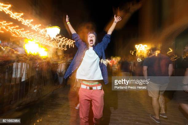 Kassadi McPherson of Cumberland lets out a shout of revelry on Wharf Street during a recent Friday night The new owner of buildings in the Old Port...