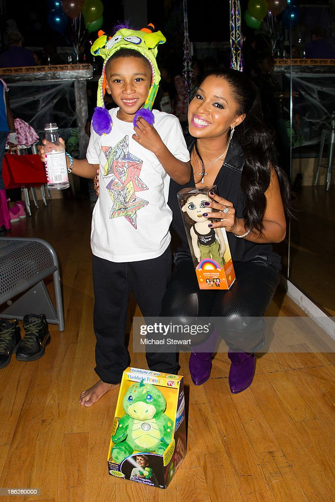 Kasseem Dean Jr. (L) and singer <a gi-track='captionPersonalityLinkClicked' href=/galleries/search?phrase=Mashonda&family=editorial&specificpeople=673897 ng-click='$event.stopPropagation()'>Mashonda</a> Tifrere attend Flipeez Presents Kasseem's Dream Halloween Party at BKLYN BEAST on October 29, 2013 in Brooklyn, New York.