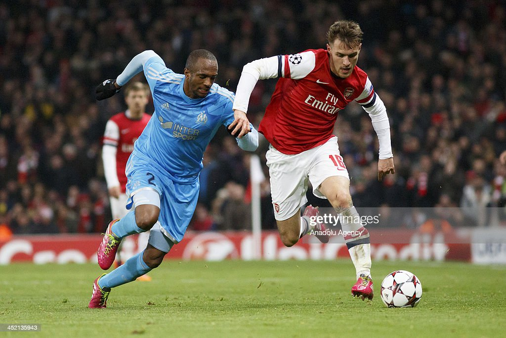 Kassim Abdallah of Marseille (L) vies with Aaron Ramsey of Arsenal (R) during the UEFA Champions League group F football match between Arsenal and Olympique de Marseille at the Emirates Stadium on November 26, 2013 in London, England.