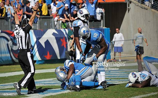 Kassim Osgood of the Detroit Lions congratulates teammate wide receiver Titus Young on scoring the game tying touchdown in the final second against...