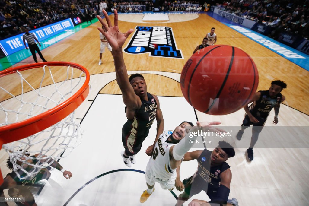 Kassius Robertson #3 of the Missouri Tigers shoots in a layup against the Florida State Seminoles during the game in the first round of the 2018 NCAA Men's Basketball Tournament at Bridgestone Arena on March 16, 2018 in Nashville, Tennessee.