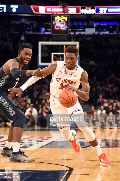 Kassoum Yakwe of the St John's Red Storm dribbles the ball during the Big East Basketball Tournament First Round game against the Georgetown Hoyas at...