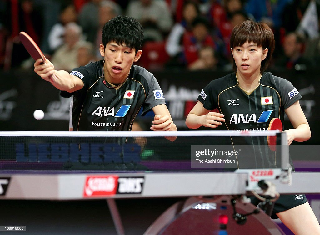 <a gi-track='captionPersonalityLinkClicked' href=/galleries/search?phrase=Kasumi+Ishikawa+-+Table+Tennis+Player&family=editorial&specificpeople=4946248 ng-click='$event.stopPropagation()'>Kasumi Ishikawa</a> (R) and Maharu Yoshimura of Japan compete in the Mixed Doubles 3rd round match against Lee Sangsu and Park Youngsook of South Korea during day four of the World Table Tennis Championships on May 16, 2013 in Paris, France.