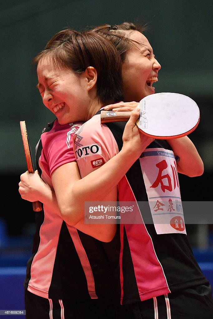 Kasumi Ishikawa (R) and Sayaka Hirano (L) of Japan celebrate after win the Women's doubles final match against Airi Abe and Mizuki Morizono of Japan during day six of All Japan Table Tennis Championships 2015 at Tokyo Metropolitan Gymnasium on January 17, 2015 in Tokyo, Japan.