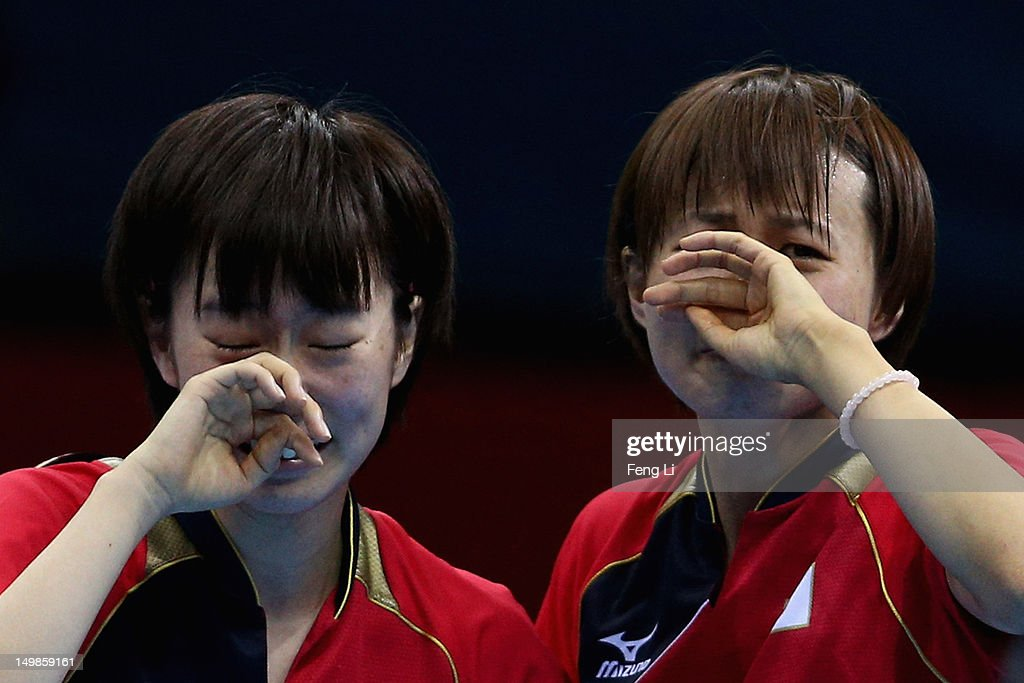 <a gi-track='captionPersonalityLinkClicked' href=/galleries/search?phrase=Kasumi+Ishikawa&family=editorial&specificpeople=4946248 ng-click='$event.stopPropagation()'>Kasumi Ishikawa</a> (L) and <a gi-track='captionPersonalityLinkClicked' href=/galleries/search?phrase=Sayaka+Hirano&family=editorial&specificpeople=661037 ng-click='$event.stopPropagation()'>Sayaka Hirano</a> of Japan celebrates after winning Women's Team Table Tennis semifinal match against team of Singapore on Day 9 of the London 2012 Olympic Games at ExCeL on August 5, 2012 in London, England.