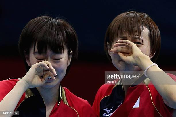 Kasumi Ishikawa and Sayaka Hirano of Japan celebrates after winning Women's Team Table Tennis semifinal match against team of Singapore on Day 9 of...