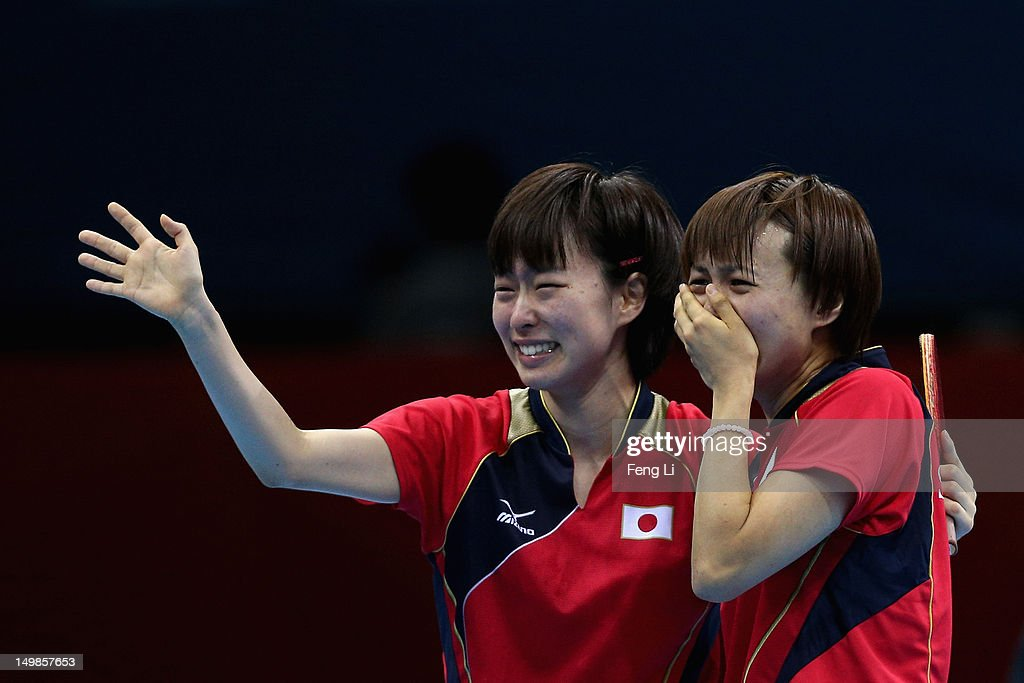 <a gi-track='captionPersonalityLinkClicked' href=/galleries/search?phrase=Kasumi+Ishikawa&family=editorial&specificpeople=4946248 ng-click='$event.stopPropagation()'>Kasumi Ishikawa</a> (L) and <a gi-track='captionPersonalityLinkClicked' href=/galleries/search?phrase=Sayaka+Hirano&family=editorial&specificpeople=661037 ng-click='$event.stopPropagation()'>Sayaka Hirano</a> of Japan celebrates during Women's Team Table Tennis semifinal match against team of Singapore on Day 9 of the London 2012 Olympic Games at ExCeL on August 5, 2012 in London, England.