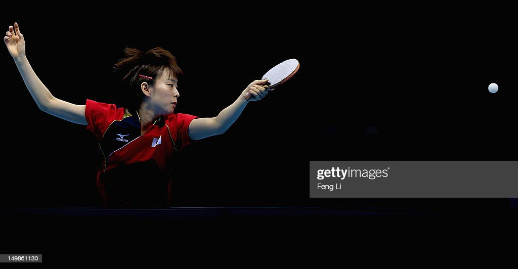 <a gi-track='captionPersonalityLinkClicked' href=/galleries/search?phrase=Kasumi+Ishikawa&family=editorial&specificpeople=4946248 ng-click='$event.stopPropagation()'>Kasumi Ishikawa</a> of Japan competes during Women's Team Table Tennis semifinal match against team of Singapore on Day 9 of the London 2012 Olympic Games at ExCeL on August 5, 2012 in London, England.