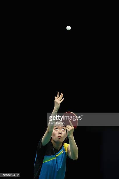 Kasumi Ishikawa of Japan in action against Ying Han of Germany during the Women's Team Semifinal 2 on Day 9 of the Rio 2016 Olympic Games at...