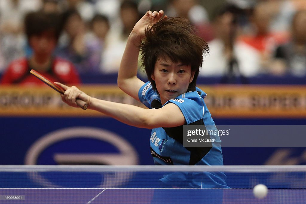 Kasumi Ishikawa of Japan returns a shot against Yu Fu of Portugal during their Women's Singles match on day two of 2014 ITTF World Tour Japan Open at Yokohama Cultural Gymnasium on June 21, 2014 in Yokohama, Japan.
