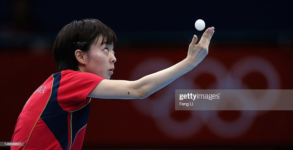 <a gi-track='captionPersonalityLinkClicked' href=/galleries/search?phrase=Kasumi+Ishikawa&family=editorial&specificpeople=4946248 ng-click='$event.stopPropagation()'>Kasumi Ishikawa</a> of Japan serves in her Women's Singles Table Tennis third round match against Li Qiangbing of Austria on Day 2 of the London 2012 Olympic Games at ExCeL on July 29, 2012 in London, England.