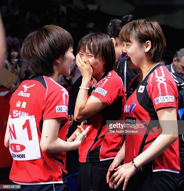 Kasumi Ishikawa Sayaka Hirano and Yuka Ishigaki of Japan celebrate winning against Hong Kong during day seven of the 2014 World Team Table Tennis...