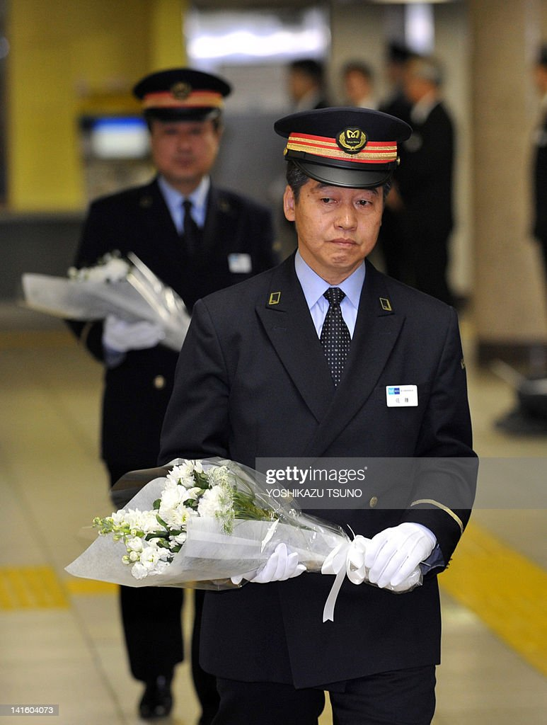 Kasumigaseki station master Kiyoji Sato offers a flower bouquet for victims of the 1995 sarin gas attacks by the Aum Supreme Truth cult group, during a memorial service at the Kasumigaseki station in Tokyo on March 20, 2012. Tokyo marked the 17th anniversary of Tokyo subway sarin gas attacks by the Aum Supreme Truth doomsday cult leaving 13 people dead and more than 6,200 others injured. AFP PHOTO / Yoshikazu TSUNO