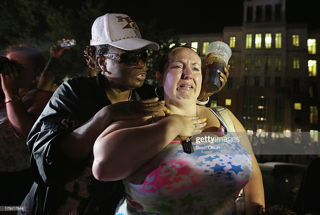 Kat Crowe (L) and Melinda O'Neal comfort each other in front of the Seminole County Criminal Justice Center after learning George Zimmerman had been found not guilty in the Murder of Trayvon Martin on July 13, 2013 in Sanford, Florida. Zimmerman, a neighborhood watch volunteer, shot and killed 17-year-old Martin after an altercation in February 2012.