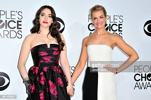 Kat Dennings and Beth Behrs arrive at the 40th Annual People's Choice Awards at Nokia Theatre LA Live on January 8 2014 in Los Angeles California