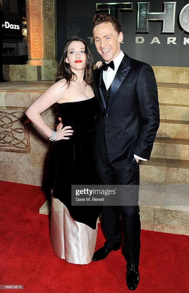 Kat Dennings (L) and Tom Hiddleston attend the World Premiere of 'Thor: The Dark World' at Odeon Leicester Square on October 22, 2013 in London, England.