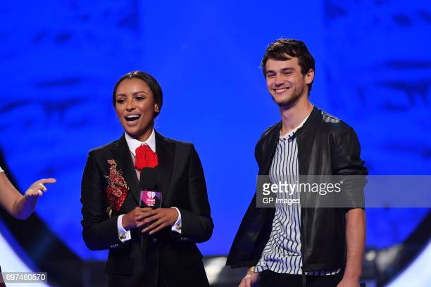 Kat Graham and Brandon Flynn present at the 2017 iHeartRADIO MuchMusic Video Awards at MuchMusic HQ on June 18 2017 in Toronto Canada