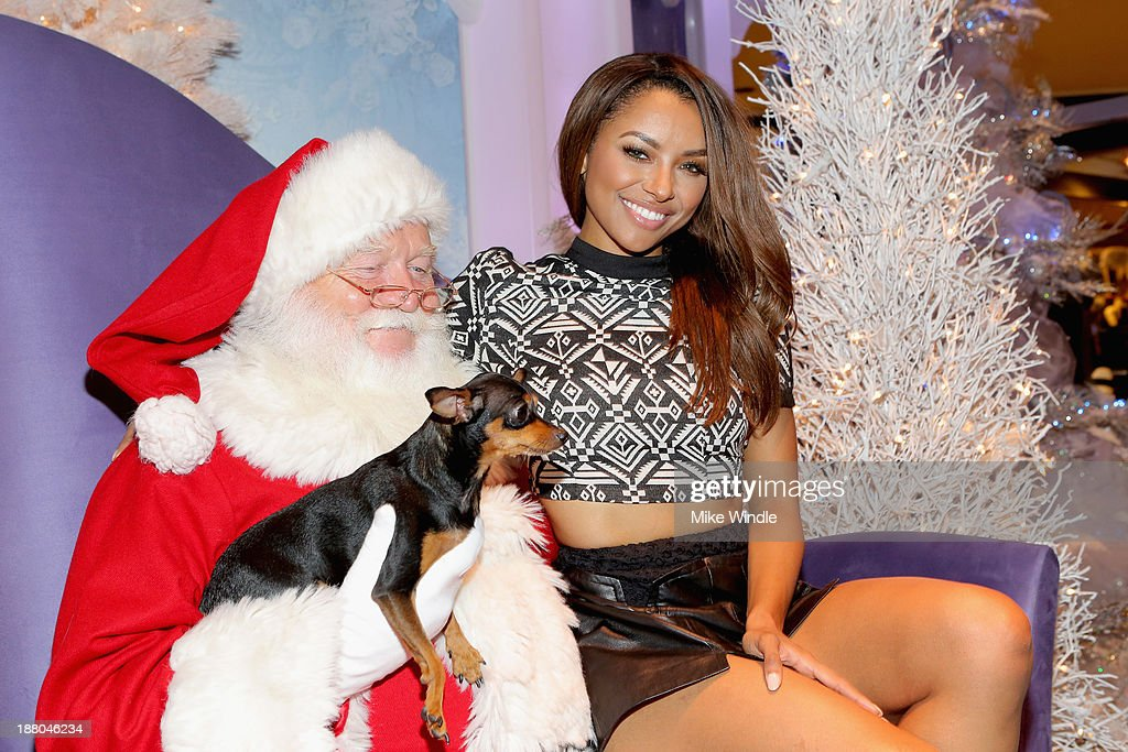 Kat Graham and her dog Izzy attend Beverly Center's Holiday Pet Portraits Debut at The Beverly Center on November 14, 2013 in Los Angeles, California.
