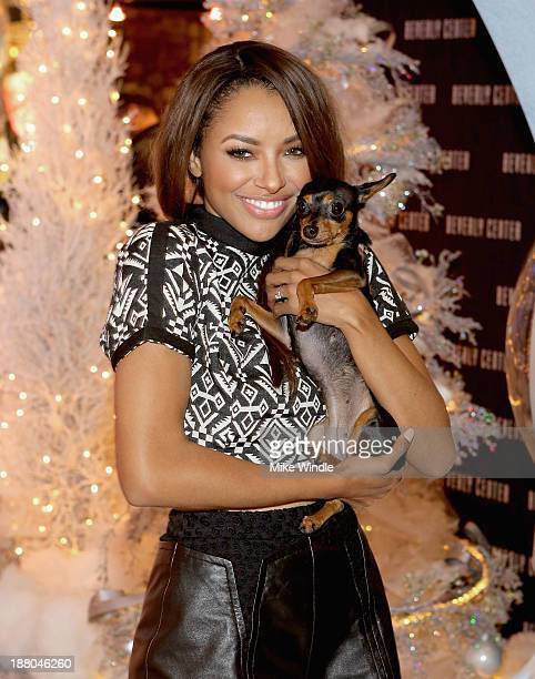 Kat Graham and her dog Izzy attend Beverly Center's Holiday Pet Portraits Debut at The Beverly Center on November 14 2013 in Los Angeles California