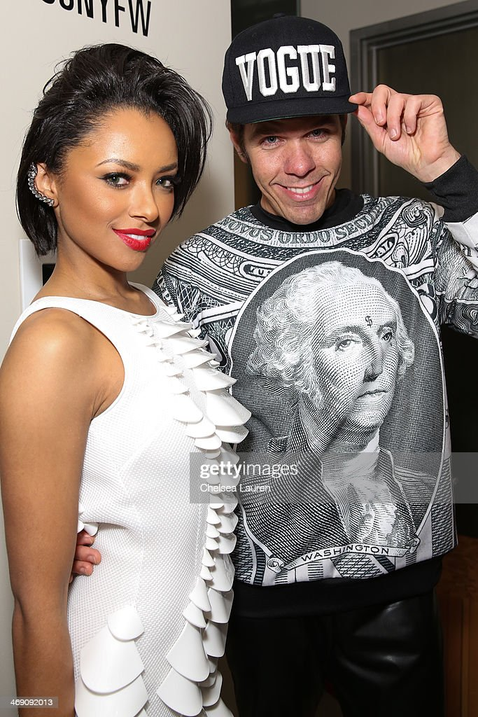 Kat Graham (L) and <a gi-track='captionPersonalityLinkClicked' href=/galleries/search?phrase=Perez+Hilton&family=editorial&specificpeople=598309 ng-click='$event.stopPropagation()'>Perez Hilton</a> backstage at the The Blonds fashion show during MADE Fashion Week Fall 2014 at Milk Studios on February 12, 2014 in New York City.