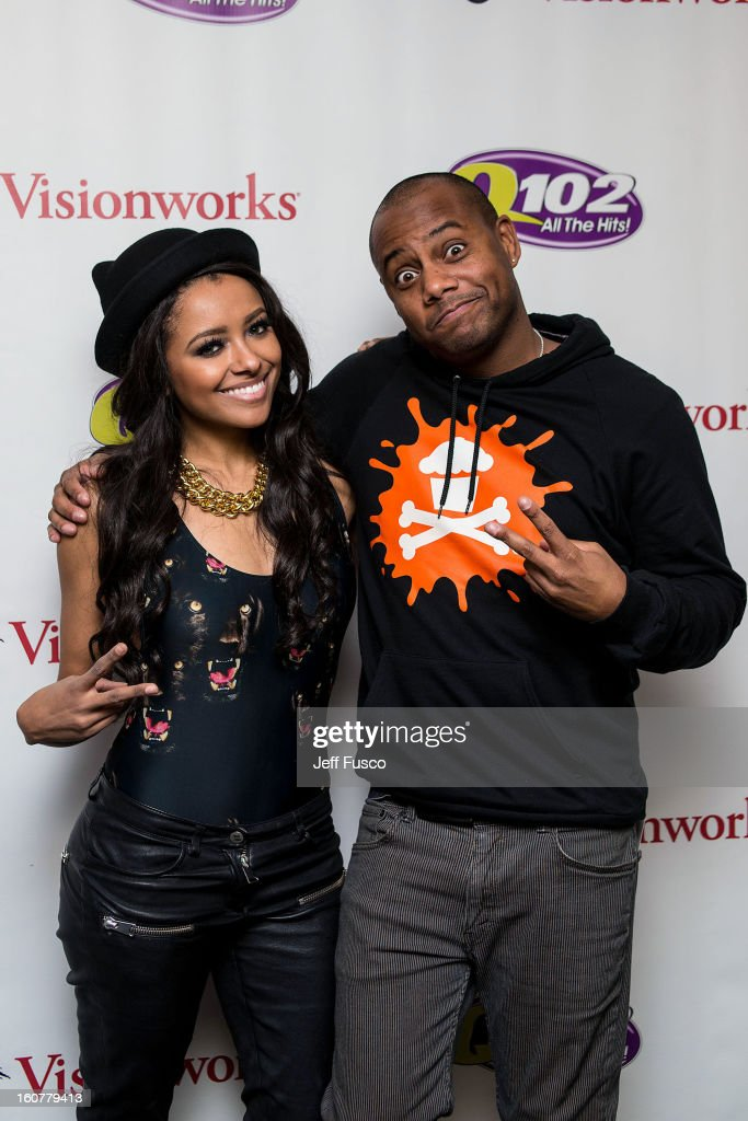 Kat Graham (L) and radio personality Maxwell pose at the Q102 iHeart Performance Theater on February 5, 2013 in Bala Cynwyd, Pennsylvania.