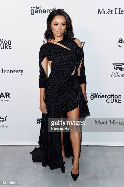 Kat Graham attends the 2017 amfAR generationCURE Holiday Party on December 1 2017 in New York City