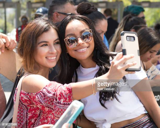 Kat Graham takes a selfie with a fan at 'Extra' at Universal Studios Hollywood on July 19 2017 in Universal City California