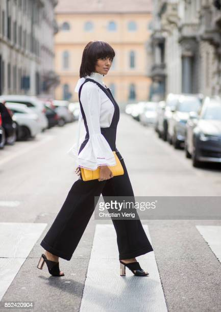 Kat Graham wearing black Philosophy jumpsuit white Fendi blouse yellow Valextra clutch heeled shoes Topshop is seen during Milan Fashion Week...