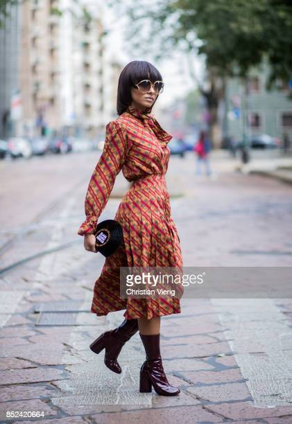 Kat Graham wearing YSL dress Marc Jacobs ankle boots Sarah clutch Dior sunglasses is seen during Milan Fashion Week Spring/Summer 2018 on September...