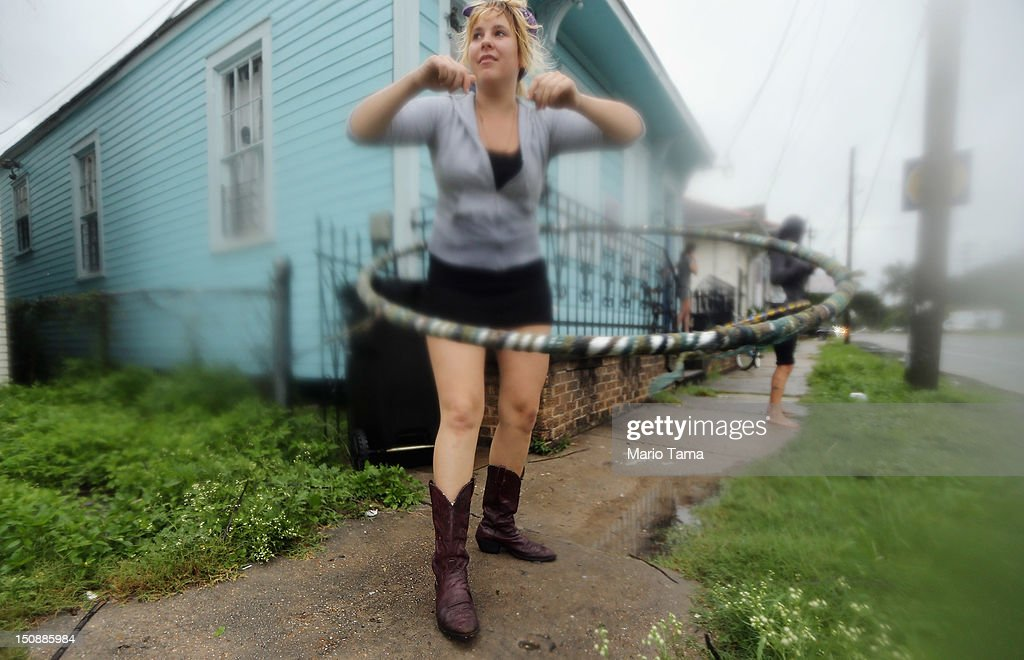 Kat Soulagnet hula hoops at a 'Hurricane Party' in the Upper Ninth Ward on August 28, 2012 in New Orleans, Louisiana. New Orleans is bracing as Hurricane Isaac, now a Category 1 storm, makes landfall.