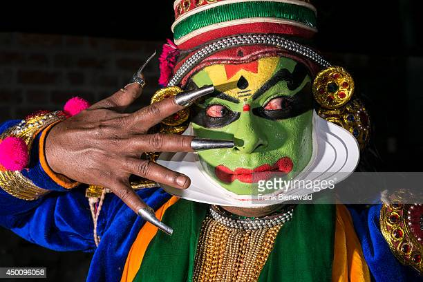 Katakali artist is posing with the complete make up of the character Krishna for the play Santhana Gopalam