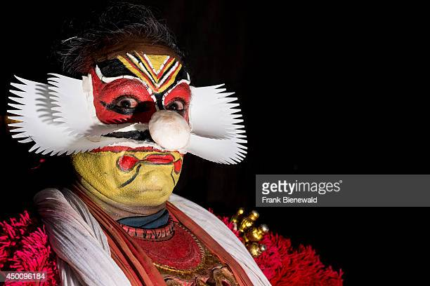 Katakali artist is posing with the complete make up of the character Virabhatra for the play Dhecheyagam