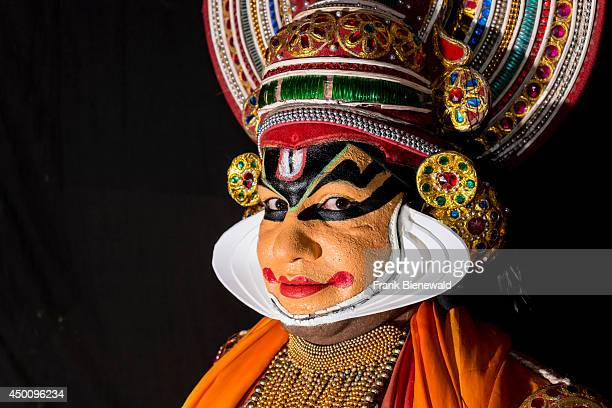 Katakali artist is posing with the complete make up of the character Shiva for the play Dhecheyagam