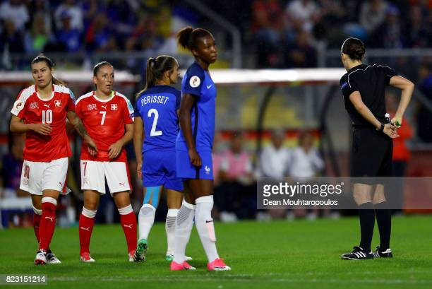 Katalin Kulcsár oh Hungary shows the red card to Eve Perisset of France during the Group C match between Switzerland and France during the UEFA...