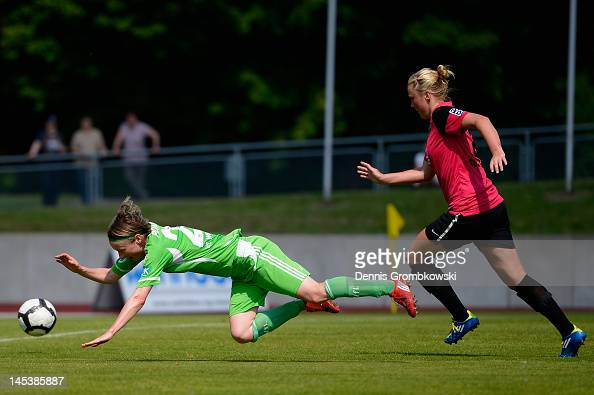Katarina Ann Tarr of Essen brings down Martina Mueller of Wolfsburg during the Women's Bundesliga match between SG EssenSchoenebeck and VfL Wolfsburg...