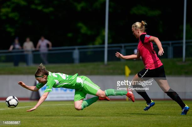 Katarina Ann Tarr of Essen brings down Martina Mueller of Wolfsburg during the Women's Bundesliga match between SG EssenSchoenebeck and VfL Wolfsburg...