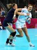 Katarina Bulatovic of Montenegro is defended by Begona Fernandez Molinos of Spain during the Women's Handball semifinal game between Spain and...