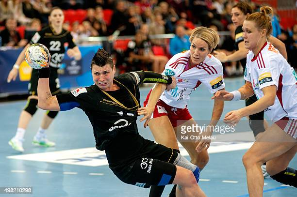 Katarina Jezic makes a shot as Gro HammersengEdin and Marit Malm Frafjord is too late to stop her in the game between Larvik HK and HCM Baia Mare on...
