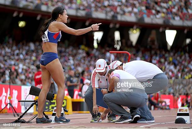 Katarina JohnsonThompson of Great Britain gestures while speaking with officials during the Women's Heptathlon Long Jump during day two of the 15th...