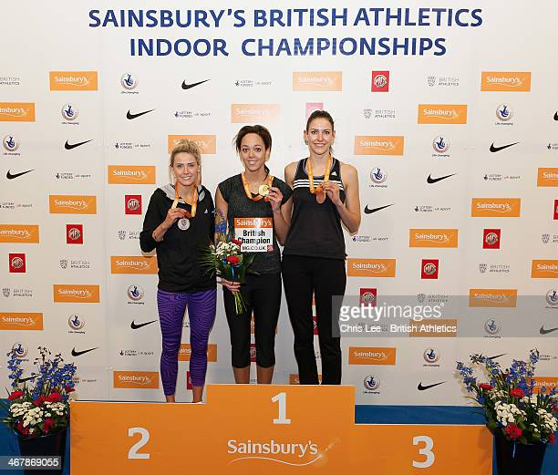 Katarina JohnsonThompson poses with her gold medal after she wins the Women's High Jump with a new national record and with second placed Jayne...