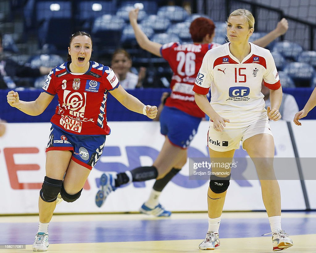 Katarina Krpez (L) of Serbia reacts near Pernille Holst Larsen (R) of Denmark during the Women's European Handball Championship 2012 Group I main round match between Serbia and Denmark at Arena Hall on December 11, 2012 in Belgrade, Serbia.