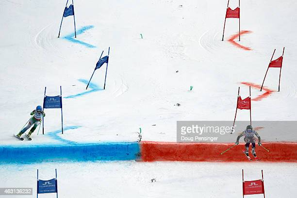 Katarina Lavtar of Slovenia races Ragnhild Mowinckel of Norway during the Nations Team Event at Golden Peak Stadium on Day 9 of the 2015 FIS Alpine...