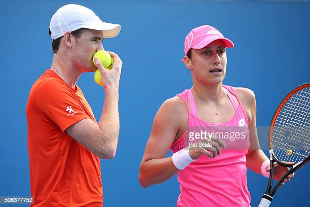 Katarina Srebotnik of Slovakia and Jamie Murray of Great Britain talk tactics in their first round match against Anastasia Rodionova of Australia and...