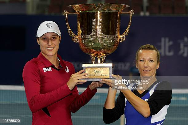 Katarina Srebotnik of Slovakia and Kveta Peschke of the Czech Republic pose for photographers after defeating Gisela Dulko of Argentina and Flavia...
