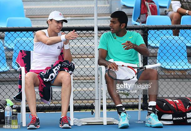 Katarina Srebotnik of Slovakia and Rohan Bopanna of India talk between games in their first round mixed doubles match against Raquel KopsJones of the...