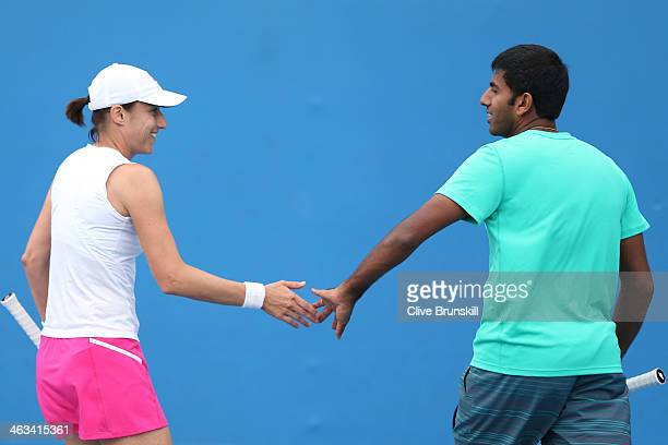 Katarina Srebotnik of Slovakia and Rohan Bopanna of India talk tactics in their first round mixed doubles match against Raquel KopsJones of the...